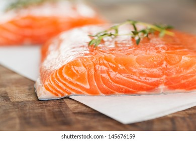 Fillets of fresh Atlantic Salmon ready for the grill - selective focus