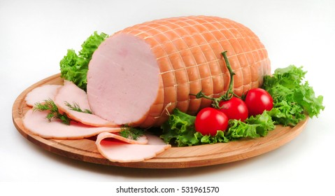 Fillets of smoked turkey/ ham on wooden board. clipping path