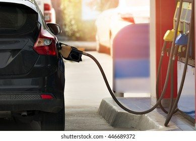 filling gasoline in car with a nozzle.