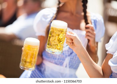Filling glass with beer. happy friends drinking draft beer and clinking glasses at bar or pub