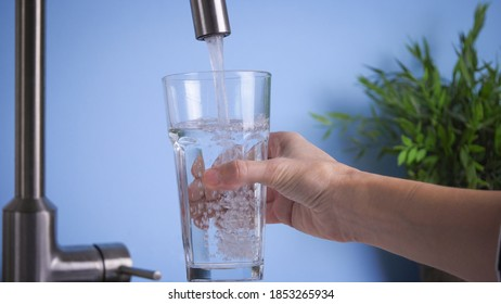 filling glass by tap water. Fresh and pure home water, drink water is healthy lifestyle. Ecological and healthy drink
