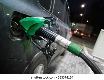 Filling modern car with petrol at an automatic gas station