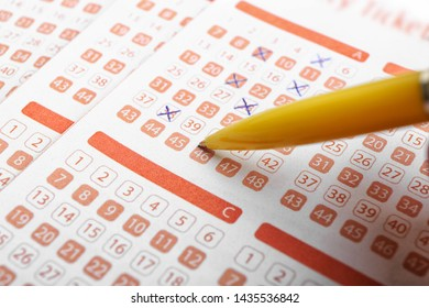 Filling out lottery ticket with pen, closeup. Space for text