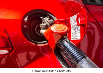 filling up petrol gas into car