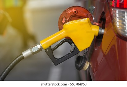 Filling petrol line into fuel inlet