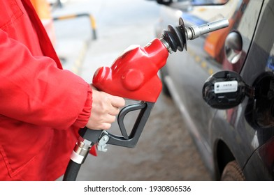 Filling station Workers with gas station guns
