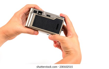 film camera in hand isolated on white.