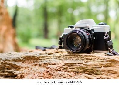 Film camera in natural outdoor, vintage look