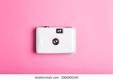 Film camera on a color minimal background. Photography, lifestyle concept