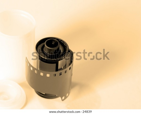 Film and canister in high-key style,slightly sennaed photo.