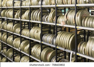Film canisters on a shelve in a film archive.