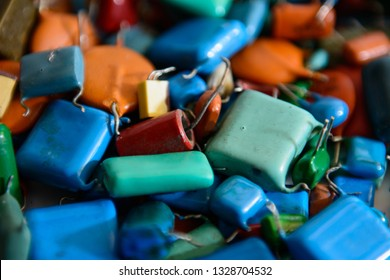 Film capacitors in blue color and other different type capacitors (ceramic). Closeup