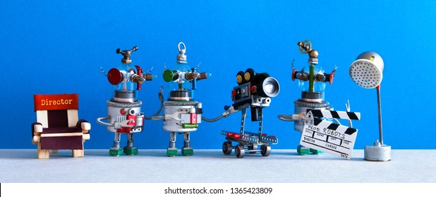 The film crew robots shoots motion picture blockbuster episode. Cinema television team robotic director, assistant with clapperboard, operator cameraman behind the scenes.