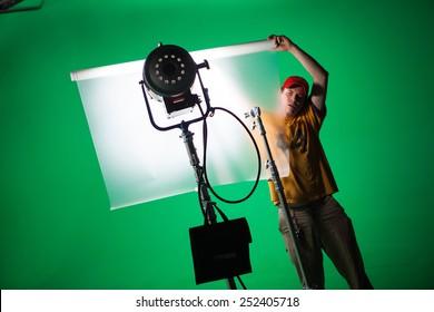film crew working in green screen studio