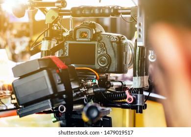Film industry. cameraman shooting film scene with camera