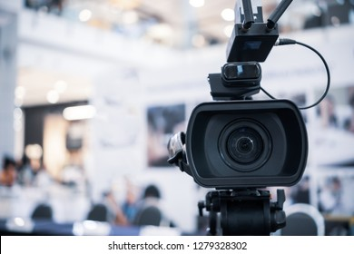 Film lens of Video camera recording film shooting of grand opening in conference hall Live streming wifi microphone sending for presentation with bokeh light background. Media Production Concept