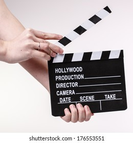 Film or Movie clapper in womans hands on white background