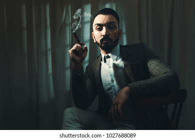 Film Noir concept of man smoking a cigar with cinematic tone