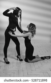 Film noir. Hitwoman with a gun threatening young beautiful girl