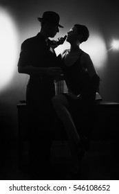 Film noir: romantic loving couple embracing in the dark, 1950s style