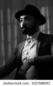 Film Noir shot of young man wearing a trilby