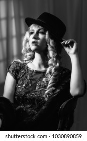 Film Noir style image of woman wearing a trilby hat
