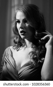 Film Noir woman with dramatic lighting