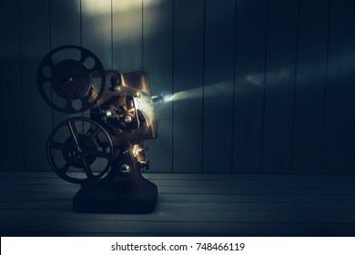 Film projector with dramatic lighting / high contrast image