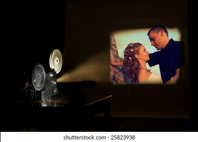 Film projector projecting a movie. Love couple on a screen. Film festival concept