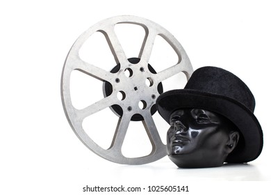 film reel of old movies and black dummy head had on white background.concept cinema