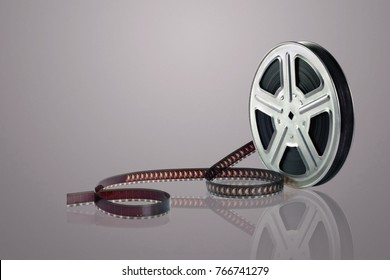 Film Reel on Reflective Surface