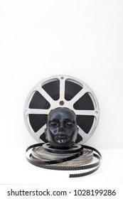 film reels of old movies and black dummy head on white background.concept cinema