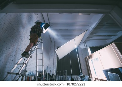 Film set and technology of modern shooting. Film crew, lighting devices, monitors, playbacks - filming equipment and a team of specialists in filming movies, advertising and TV series