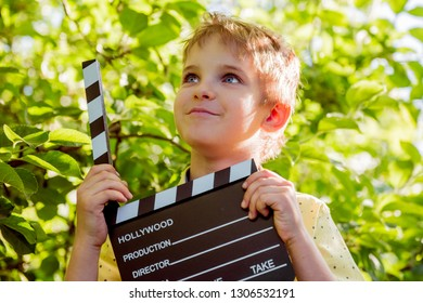 Film is shot, Filming of children's film, Cartoons for children. Take pictures of children's portraits. Casting children for a role in the cinema. Boy with a cracker