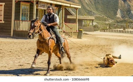 film specialist doing scene of cowboys dragging the bandit tied to the horse