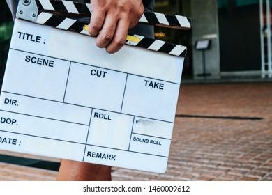 Filming crew,Man hands holding movie clapper.