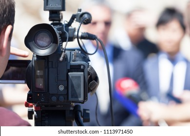 Filming media event with a video camera