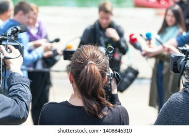 Filming news conference or media event with a video camera