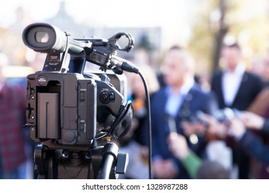 Filming news conference with television camera