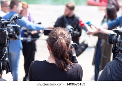 Filming press conference or media event with a video camera