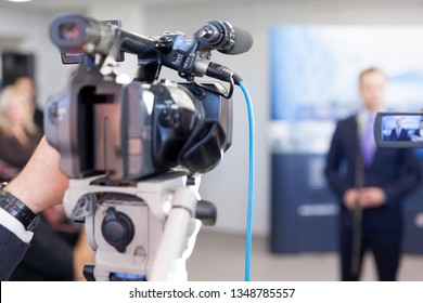 Filming press or news conference with a video camera