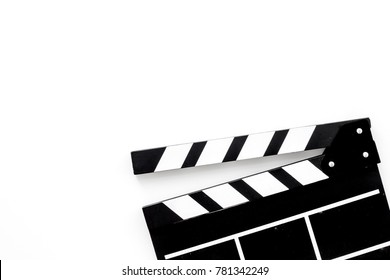 Filmmaker profession. Clapperboard on white background top view