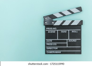 Filmmaker profession. Classic director empty film making clapperboard or movie slate isolated on blue background. Video production film cinema industry concept. Flat lay top view copy space mock up