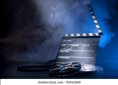 filmmaking concept scene with clapper and dramatic lighting