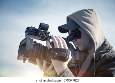 Filmmaking. Men with High Definition Modern Video Camera Shooting Some Video.