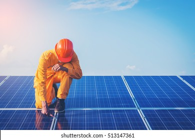 Filter and tone ;electrician working on checking and maintenance equipment at industry solar power; engineer standing on solar panel and feeling freedom at view point