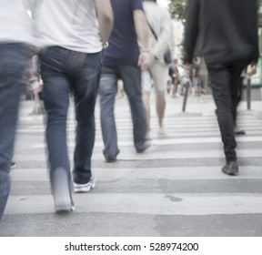filtered blur abstract  background, unrecognizable silhouettes of people walking on a street