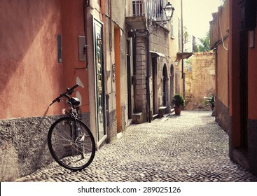 Filtered image of a bicycle on the narrow street of Bellagio town at the famous Italian lake Como