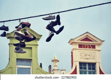 Filtered picture of shoes hanging from a power line in Ghent, Belgium