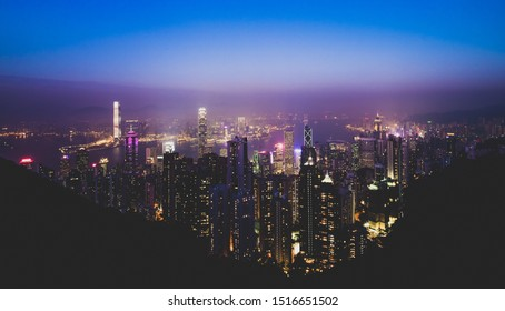 (Filtered picture) View from above, stunning view of the illuminated Hong Kong skyline during a beautiful sunset. Picture taken from the Victoria Peak.